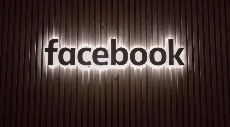 image of Facebook on metal background
