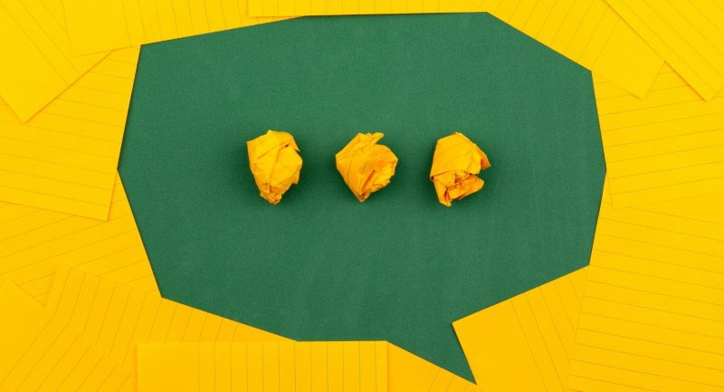 green speech box on yellow background