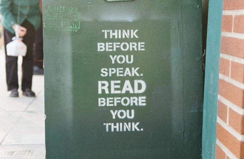"""Caption on side of green receptacle """"thing before you speak. Read before you think."""" LinkedIn tips"""